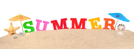 Summer letters on a beach sand on a white background Imagens