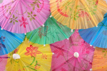 cocktail umbrella: Colorful paper cocktail umbrella close-up as background