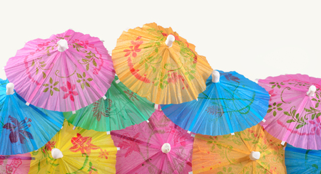 cocktail umbrella: Colorful paper cocktail umbrella close-up on a white background