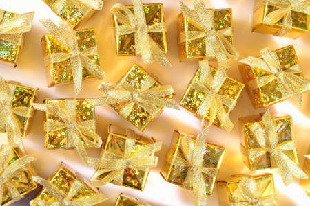 Top view of golden gifts close-up as background Stock Photo
