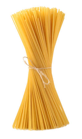 Bunch of uncooked Italian pasta spaghetti on a white background