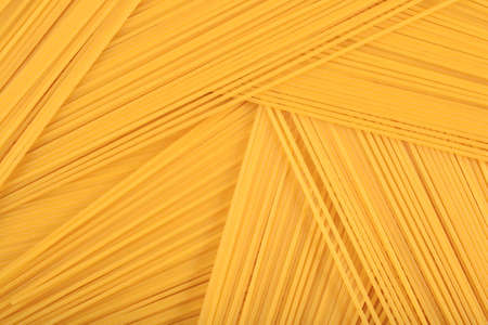 uncooked: Uncooked Italian pasta spaghetti as background texture