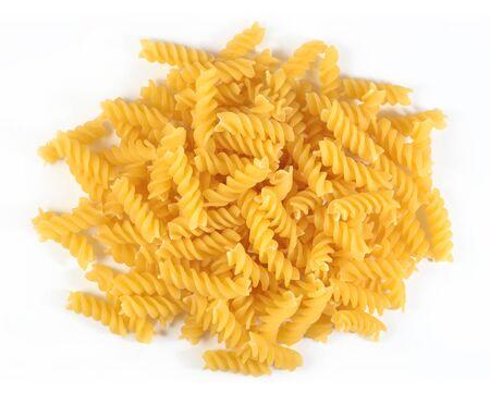 fusilli: Heap of uncooked italian pasta fusilli on a white background