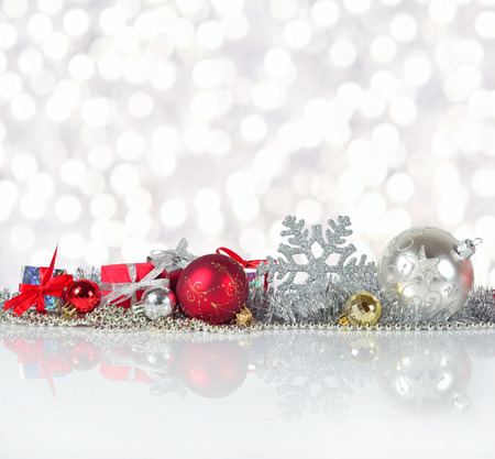 red and silver christmas decorations on a bokeh background stock photo 63187336 - Silver Christmas Decorations