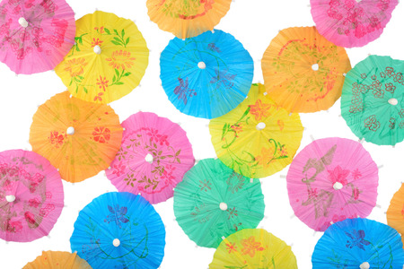 paper umbrella: Colorful paper cocktail umbrellas close-up on a white background