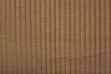pleated: Black pleated transparent caprone cloth on a brown background close up Stock Photo