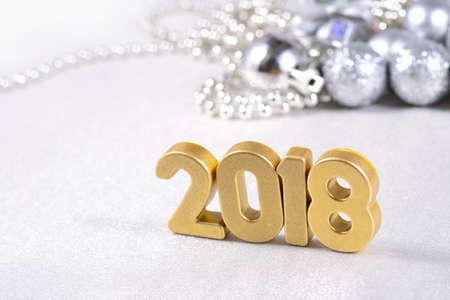 2018 year golden figures on the background of silvery Christmas decorations Stock Photo