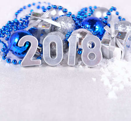 silvery: 2018 year silver figures on the background of silvery and blue Christmas decorations