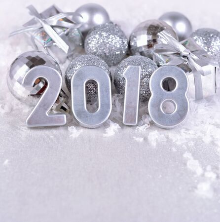 silvery: 2018 year silver figures on the background of silvery Christmas decorations