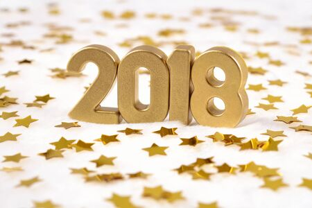 2018 year golden figures and golden stars on a white background Stock Photo