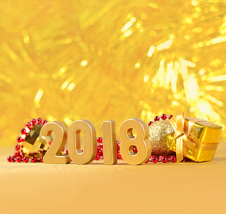 2018 year golden figures and Christmas decorations on a bokeh background
