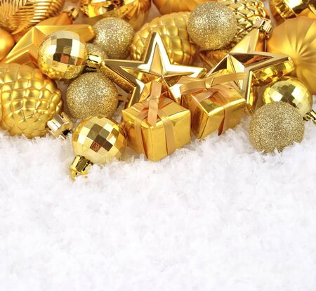 Golden Christmas decorations on a white background