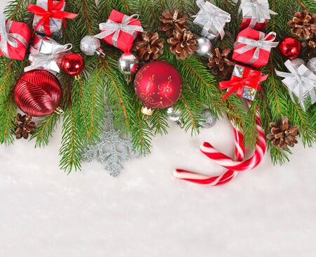 Christmas decorations on a spruce branch on a white background