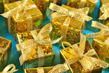 tradition: Top view of golden gifts close-up on a blue background