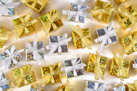 tradition: Top view of golden and silver gifts close-up on a white background Stock Photo