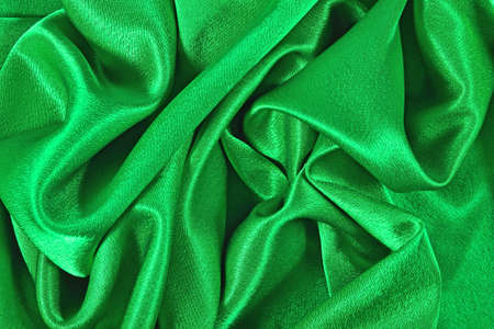 Natural green satin fabric as background texture Stock Photo