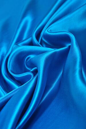 Natural blue satin fabric as background texture