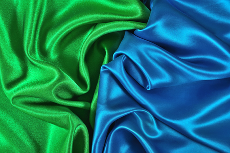 Natural blue and green satin fabric as background texture Imagens