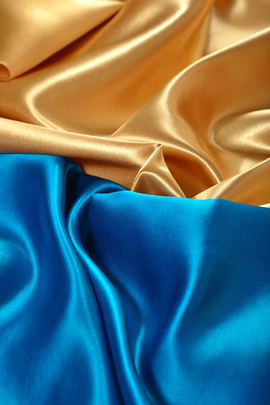 Natural golden and blue satin fabric as background texture