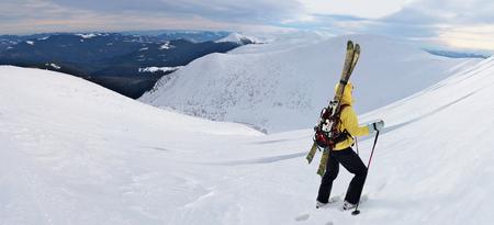 Alpine touring skier hiking in winter mountains. Carpathians, Ukraine. Imagens