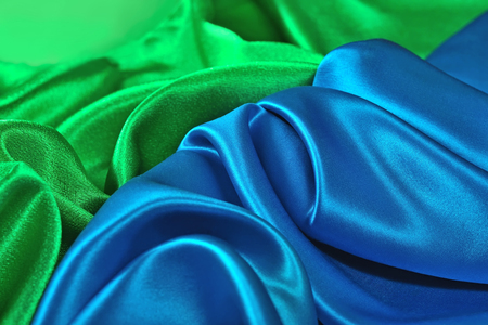 Natural blue and green satin fabric as background texture Stock Photo
