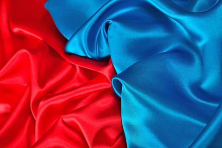 Natural blue and red satin fabric as background texture Stock Photo