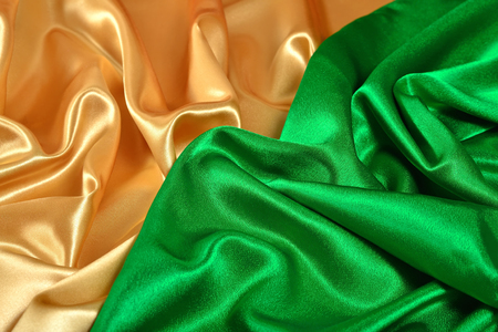 Natural golden and green satin fabric as background texture