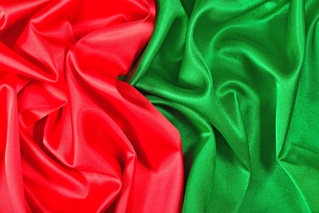 Natural red and green satin fabric as background texture