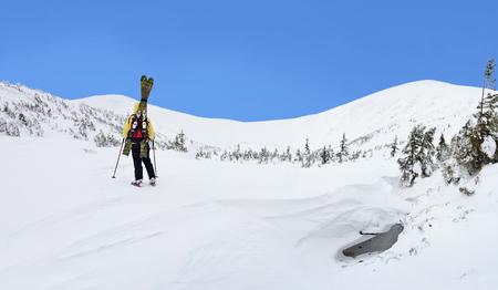 Alpine touring skier in winter mountains. Carpathians, Ukraine.