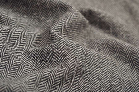 Draped herringbone tweed wool fabric as texture