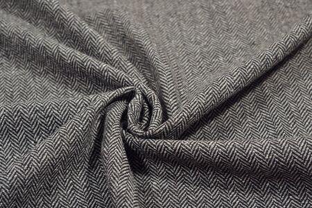 Draped herringbone tweed wool fabric as background texture Stock Photo