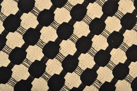 Fabric with a woven ornament as background texture