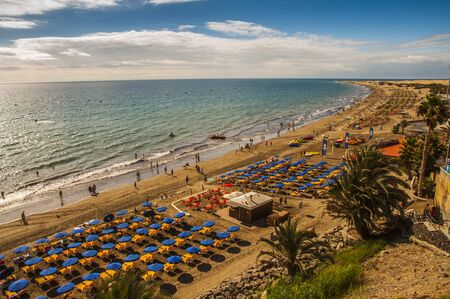 English beach on the island of Gran Canaria in Maspalomas dunes beside