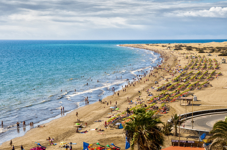 scilly: English beach on the island of Gran Canaria in Maspalomas dunes beside