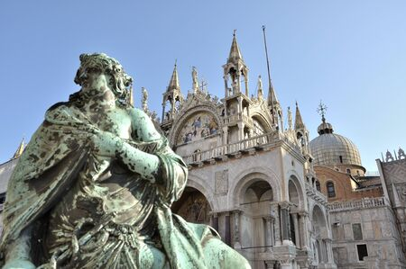 marcos: Historical landmark in Venice, Italy called San Marcos. Shabby statue on foreground. Stock Photo