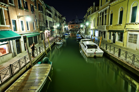 grand canal: Beautiful view on illuminated Grand canal with lots of vessels Stock Photo