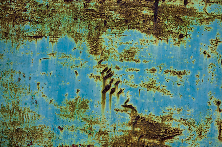 metal corrosion: Blue aged metal wall with corrosion in close-up