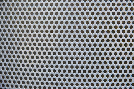 perforated: Close-up of perforated metal backdrop