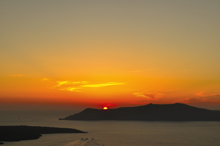 View of the famous island desantorini in greece at sunset