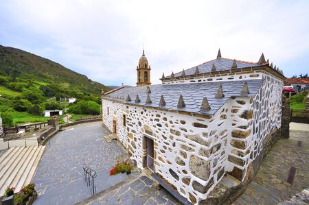 church of San Andreas de Teixido on the coast of death in galicia tells the lellenda that who does not live goes from dead Stock Photo