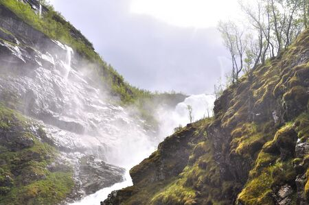 The Kjosfossen waterfall seen from the famous flam train in Norway 写真素材