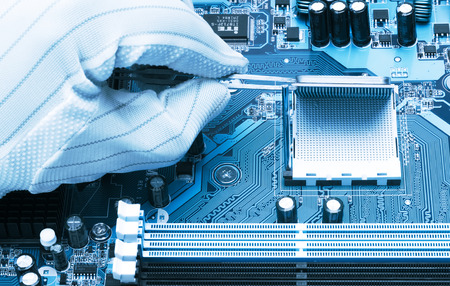Installation of modern processor in CPU socket on the motherboard 版權商用圖片