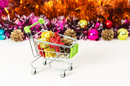 New Year Trolley with Christmas toys, buy a gift for the New Year