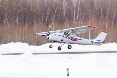 Small plane landed at the airport in winter Stock Photo