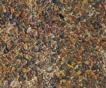 seamless texture of pebbles under water