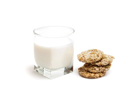 isolated glass of milk and four cookies
