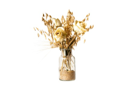 dry flowers and barley in bottle with sand Stock Photo