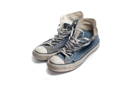 old dirty blue sneakers with lace Stock Photo