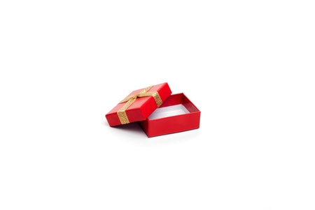 opened red gift box with gold ribbon