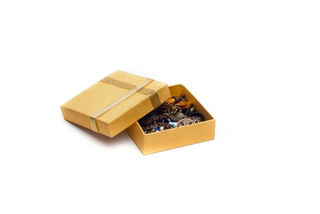 opened yellow gift box with gold ribbon and jewelry